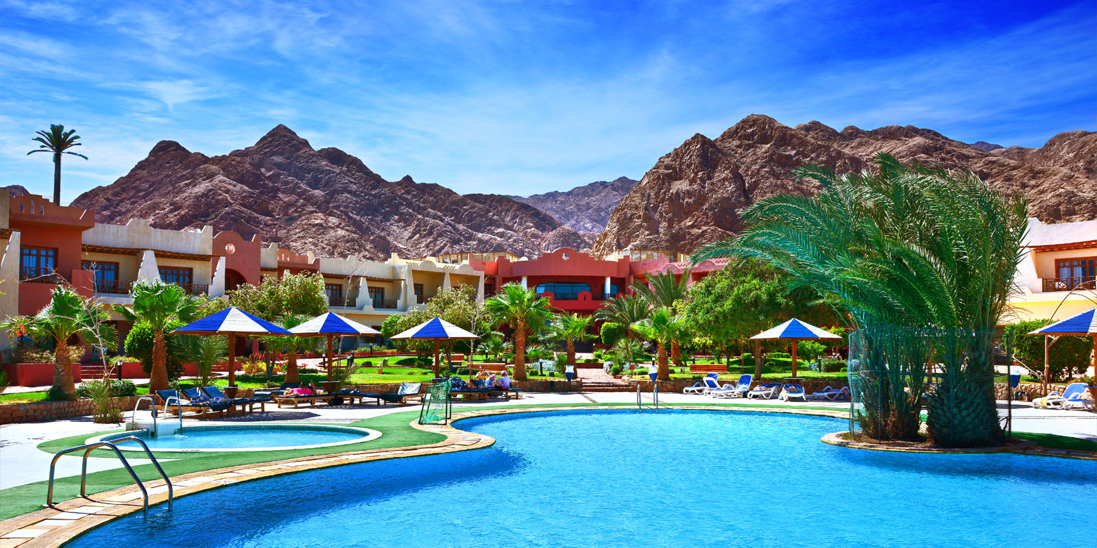 Tropitel-Dahab-Oasis-Header-Pool-Mountain